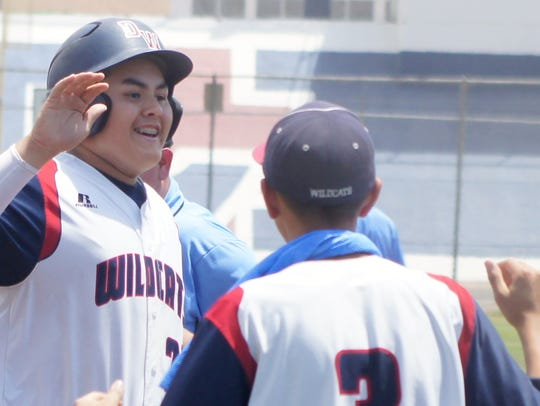 Freshman Eduardo Sanchez, left, is all smiles after