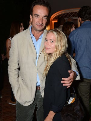 Olivier Sarkozy and Mary Kate Olsen attend 4th Annual Apollo In The Hamptons Benefit on August 24, 2013 in East Hampton, New York.