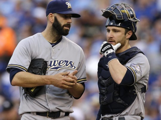Milwaukee Brewers starting pitcher Mike Fiers, left, talks with catcher Jonathan Lucroy after giving up a run during the second inning against the Kansas City Royals at Kauffman Stadium in Kansas City, Mo. on Wednesday.
