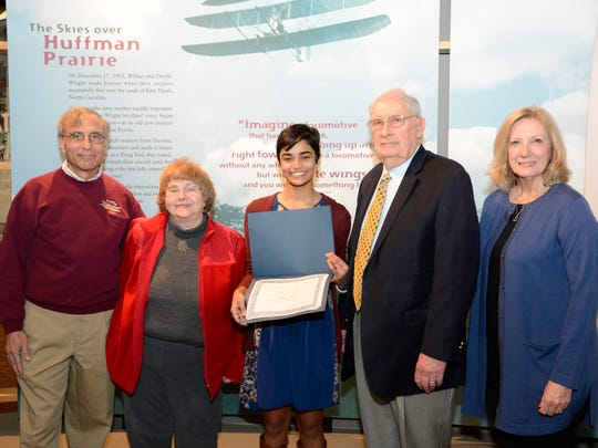 Mullika Pandit, 15, center, won the NAHA's Mitchell Cary-Dun Gum Memorial Aviation Scholarship. She stands with Jay Jabour, chairman of Wright B Flyer Inc., Janet Gum, widow of Don Gum, Frank Winslow, NAHA chair, and Judy Barazzotto, widow of Mitch Cary.