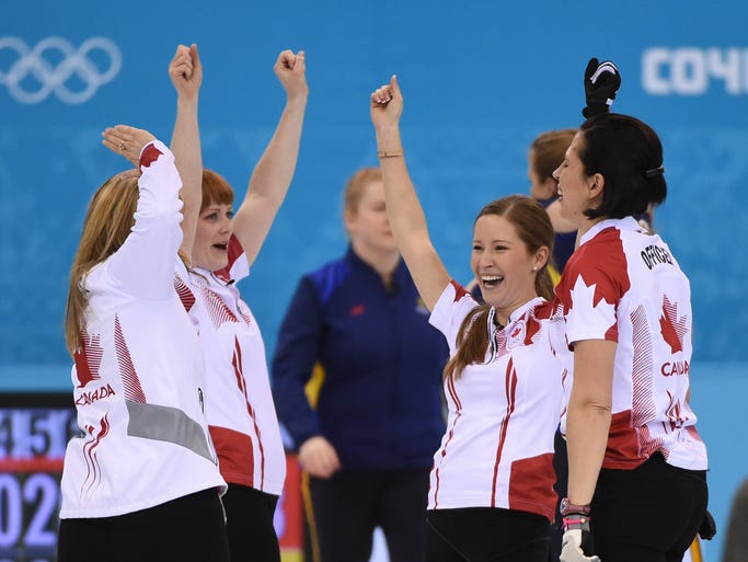 The Canadian team celebrates after winning the gold medal in the women's curling.