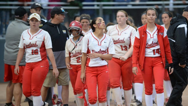 Vineland players exit the field after losing the Group 4 softball state final to North Hunterdon 6-5 in 10 innings at Kean University on Sunday. 06.03.18.
