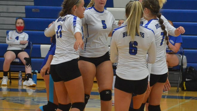 Inland Lakes volleyball players celebrate a point against Hillman on Tuesday. On Thursday, the Bulldogs split a pair of matches, beating Engadine but losing to Rudyard.
