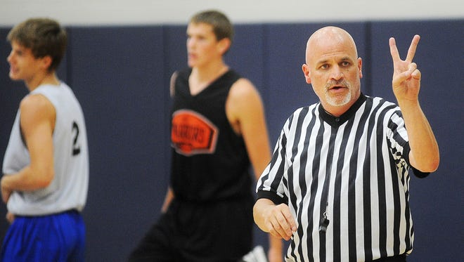 Bret LaCroix, a licensed SDHSAA official, officiates a Summer Jam Basketball League game during the 2014 SDHSAA Officials Jamboree in July.