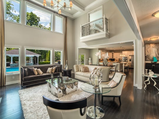 The two-story great room leads out to the backyard