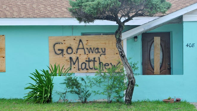 Residents of Cocoa Beach prepare for the impact of Hurricane Matthew.