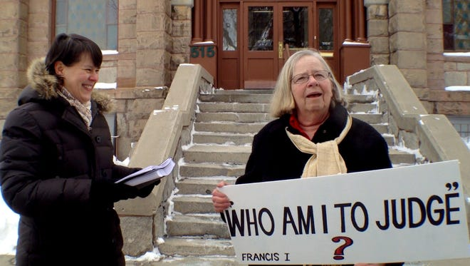 Susan Hawthorne, left, and Margaret Rankin, supporters of fired Butte Central teacher Shaela Evenson, deliver a petition with 20,000 signatures calling on the Helena Diocese to reinstate her. Evenson is suing the school that fired her.