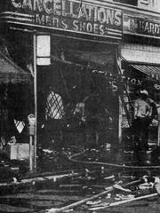 "Cancellations Men's Shoes is shown burned down on July 23, 1967. Photo was taken from Free Press page. Headline on the page, ""Fire: A Fearsome Weapon of the Rioters."" From the Detroit Free Press, July 24, 1967."