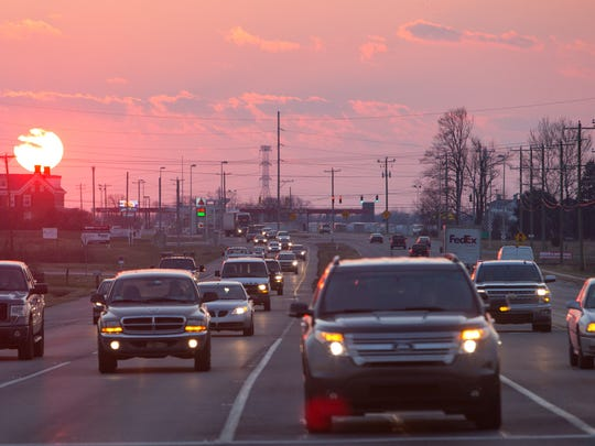 Traffic passes along Route 301 in Middletown.