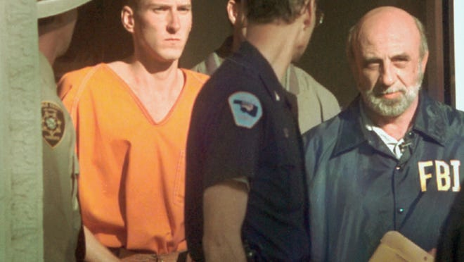 State and federal law enforcement agents lead Timothy McVeigh, second from left, from the Noble County Courthouse in Perry, Okla, April 21, 1995. He had just been identified as a suspect in the bombing of the Oklahoma City federal building.
