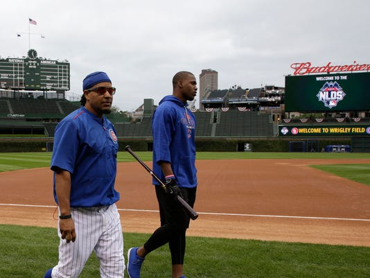 In this Oct. 13, 2015, photo, Manny Ramirez walks with Chicago Cubs' Jorge Soler during batting practice before Game 4 in baseball's National League Division Series between the Cubs and the St. Louis Cardinals in Chicago. Ramirez isn't listed on either the coaching or support staffs as Chicago heads into the NL Championship Series. Yet nearly every hitter on the roster checks in with him regularly and the team's young Latin players--budding stars Jorge Soler and Javier Baez, in particular--also revere him as some kind of life coach or guru. (AP Photo/Nam Y. Huh)