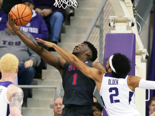 SMU guard Shake Milton (1) shoots against TCU guard Shawn Olden (2) during the first half of an NCAA college basketball game in Fort Worth, Texas, Tuesday, Dec. 5, 2017. (AP Photo/LM Otero)