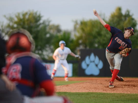 Tipton-Rosemark's Houston Hall pitches against USJ Tuesday evening.