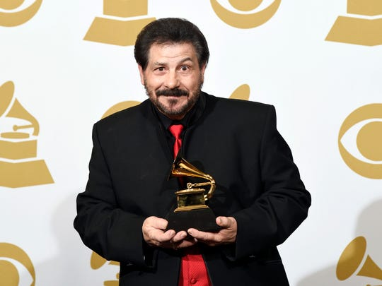 "Jo-El Sonnier poses in the press room with the award for best regional roots music album for ""The Legacy"" at the 57th annual Grammy Awards at the Staples Center on Sunday in Los Angeles."