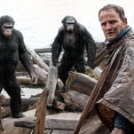 "Jason Clarke, as Malcolm, and (background from left) Andy Serkis, as Caesar, Toby Kebbell, as Koba and Karin Konoval, as Maurice in a scene from ""Dawn of the Planet of the Apes."""