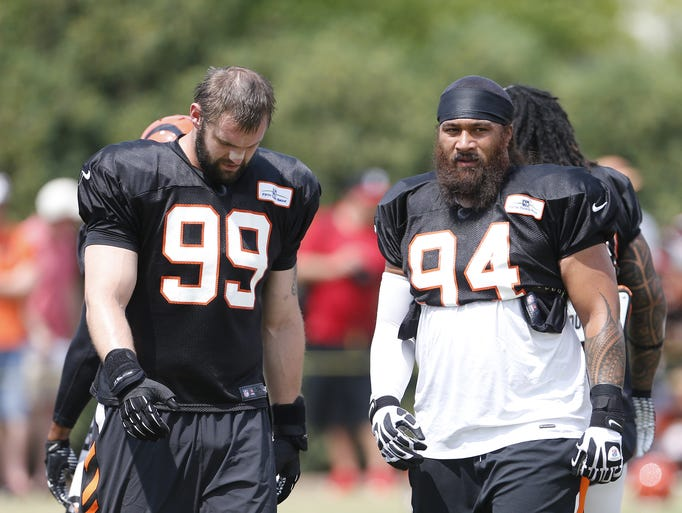 Cincinnati Bengals defensive end Margus Hunt, left, and defensive tackle Domata Peko are photographed during practice.