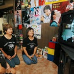 In this 2006 file photo, members of the Hawaii K-Drama Fan Club watch Korean DVDs together at Nora Muramoto's home in Pearl City, Hawaii.