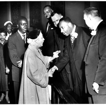 Martin Luther King Jr. stands with Dr David Evans,