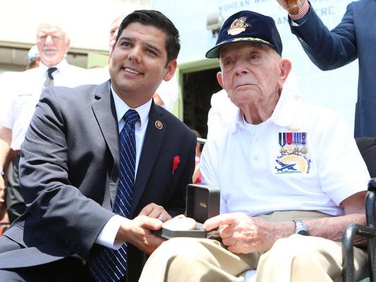 From left, Congressman Raul Ruiz presents the Congressional Gold Medal to fighter ace Fritz Payne during a Memorial Day ceremony.