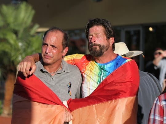 Scenes from the vigil organized by the LGBT Community Center of the Desert in response to gunman killing 50 people at a gay nightclub in Orlando held on Arenas Road in Palm Springs Sunday evening, June 12, 2016.