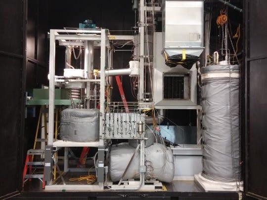 ORNL's molten salt reactor test loop simulates salt cooling of solid uranium fuel.