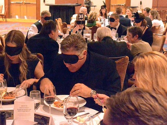 Guests at Bosma Enterprises Dining in the Dark fundraiser
