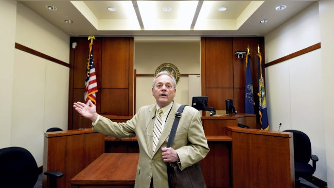 In this June 2014 file photo, York County President Judge Stephen P. Linebaugh discusses the difference in size between the eight recently completed courtrooms and courtrooms that have been in use since 2004 when the York County Judicial Center opened. The new courtrooms are smaller because no jury boxes are required for juvenile and family court hearings.
