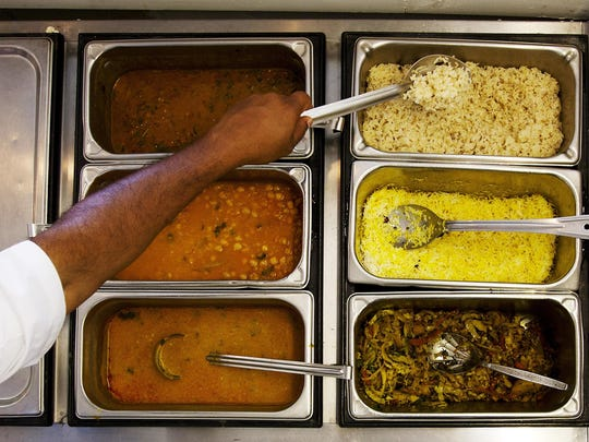 Owner Nitin Jadhav shows the many Southern Indian dishes
