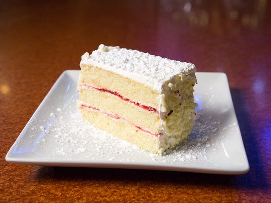 A complimentary slice of white chocolate and strawberry layer cake awaits moms who order any Chompie's entree.