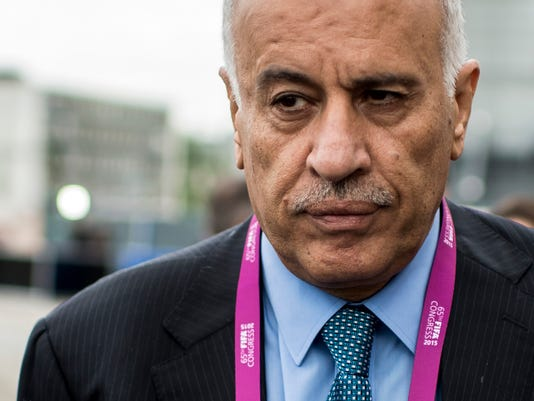 Head of the Palestinian Football Association Jibril Rajoub talks to media in front of the Hallenstadion in Zurich, Switzerland, where the 65th FIFA congress takes place, Friday, May 29, 2015. (Ennio Leanza/Keystone via AP)