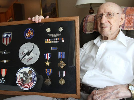 Donald Quigley poses with a collection of medals he earned as a fighter pilot and commanding officer with the Flying Tigers 23rd Fighter Group/75th Fighter Squadron stationed in Hengyang, China. Quigley shot down five Japanese aircraft on the way to earning a Silver Star, a Distinguished Flying Cross with Oak Leaf Cluster, and an Air Medal with Oak Leaf Cluster. Quigley was shot down Aug. 10, 1944, and was held as a prisoner or war for 13 months before his release at the end of the war.