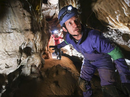 """CJ reporter Chris Kenning, right, moves through a corridor in the """"New Discovery"""" area of Mammoth Cave N.P. followed by Cave Research Foundation volunteer Elizabeth Winkler. June 30, 2015"""