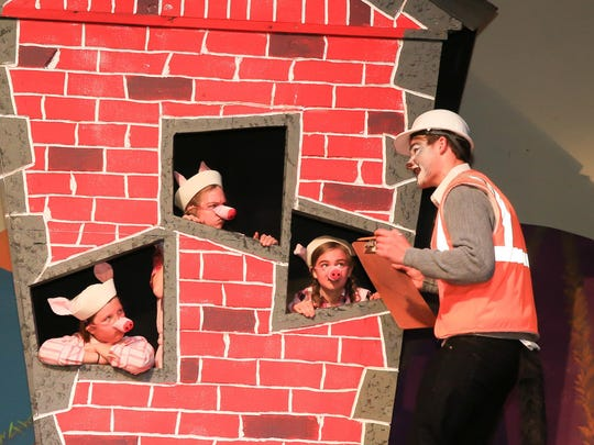 Papa Wof (Zachary Ludden) talking to the three little pigs (L-R) Joanna Cauthon, Brooke Ludden & Rachel Ludden)