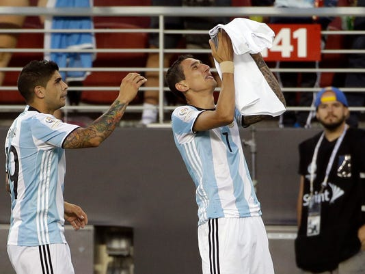 """Argentina's Angel Di Maria, right, holds a t-shirt that reads """"grandmother I will miss you a lot"""" after he scored against Chile during a Copa America Centenario Group A soccer match at the Levi's Stadium in Santa Clara, Calif., Monday, June 6, 2016. At left is Argentina's Ever Banega. (AP Photo/ Marcio Jose Sanchez)"""