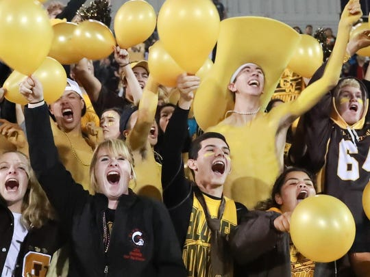 Golden West fans cheer on their team against El Diamante in the 2016 Battle of the Saddle at Community Stadium. The Trailblazers won 22-14.