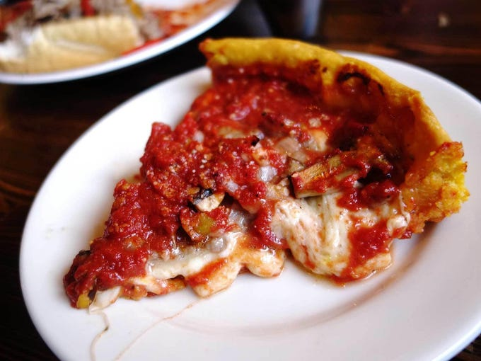 Deep dish pizza at Gino s East