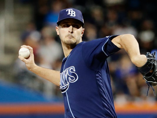 Tampa Bay Rays' Jake Odorizzi delivers a pitch during the first inning of a baseball game against the New York Yankees, Monday, Sept. 11, 2017, in New York. The Yankees will be the visiting team for the series moved from St. Petersburg, Florida, because of Hurricane Irma. (AP Photo/Frank Franklin II)