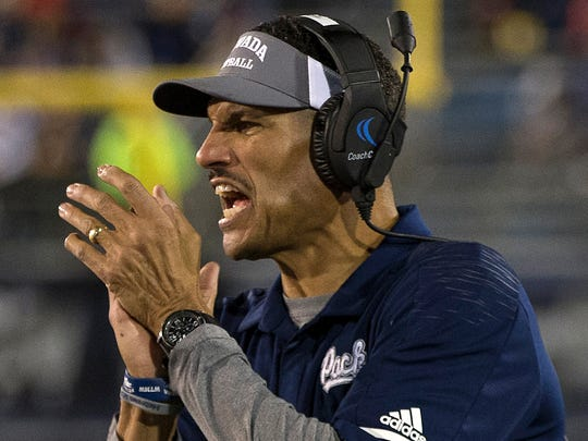 FILE - In this Oct. 27, 2018, file photo Nevada head coach Jay Norvell works the sidelines during the first half of an NCAA college football game against San Diego State in Reno, Nev. Norvell is trying to temper his team's excitement over a come-from-behind victory in the season opener with the reality of what the Wolf Pack face next: No. 16 Oregon. (AP Photo/Tom R. Smedes)