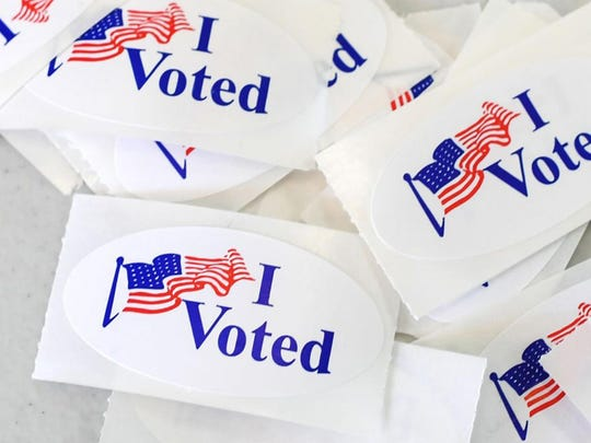 People in Pennsylvania will have the option of requesting and submitting an absentee ballot under a new law during an in-person visit to county elections offices. (Robyn Beck/AFP/Getty Images/TNS)