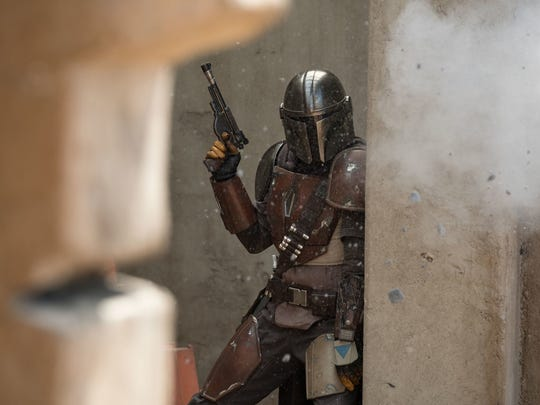 Pedro Pascal in a scene from the Disney+ original series  The Mandalorian .