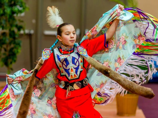 Jaysa Rasmussen, Wausau, performs a Native American dance at the Marshfield Cultural Fair held at UW-Marshfield/Wood County on Saturday Feb. 28, 2015
