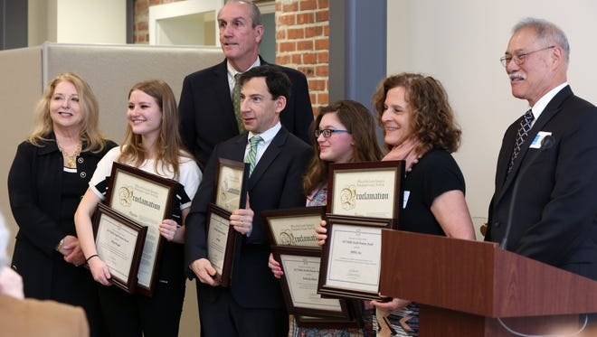 Public health award recipients Horace Greeley senior Chloe Krugel, Joe Rogot of New Rochelle, Mahopac ninth-grader Emily Gualdino and Betti Weimersheimer of Rye with health commissioner Sherlita Amler, deputy county executive Kevin Plunkett and board president Steven Nakashima after being recognized by the Westchester County Board of Health for their public-health contributions at HRHCare Community Health in Peekskill.
