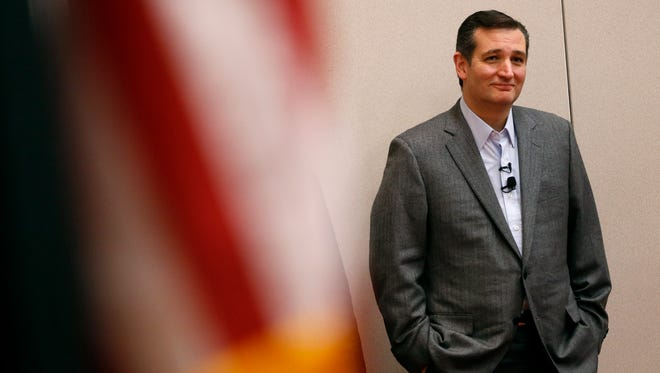 Republican Sen. Ted Cruz listens as Congressman David Young introduces his Thursday, April 2, 2015, at a town-hall style meeting in Des Moines.