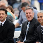 US former national player Joe Max Moore , Sporting KC head coach Peter Vermes, and US Soccer director Sunil Gulati (left to right) are seated together during the National Soccer Hall of Fame induction at Sporting Park.