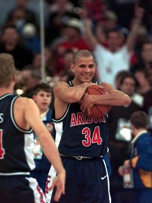 Arizona's Miles Simon clutches the game ball as he celebrates after his team's 84-79 overtime win over Kentucky Monday, March 31, 1997, at the NCAA Final Four tournament in Indianapolis.