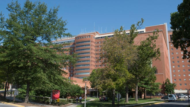 A U.S. health worker with Ebola is heading to the National Institutes of Health Clinical Center in Bethesda, Md.