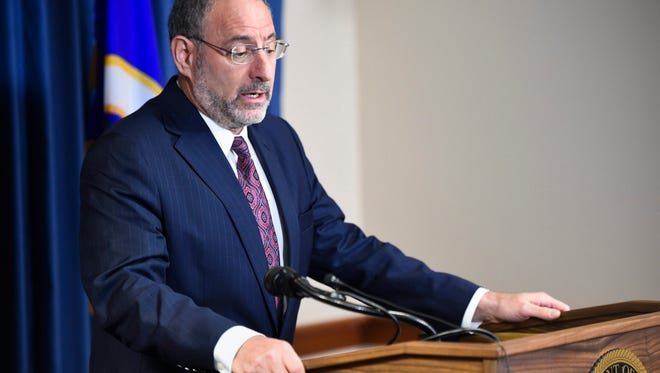 U.S. Attorney Andrew M. Luger speaks at a news conference about the arrest of six Minnesota men for conspiracy and attempt to provide material support to a foreign terrorist organization, namely, the Islamic State of Iraq and the Levant (ISIL) in Minneapolis.