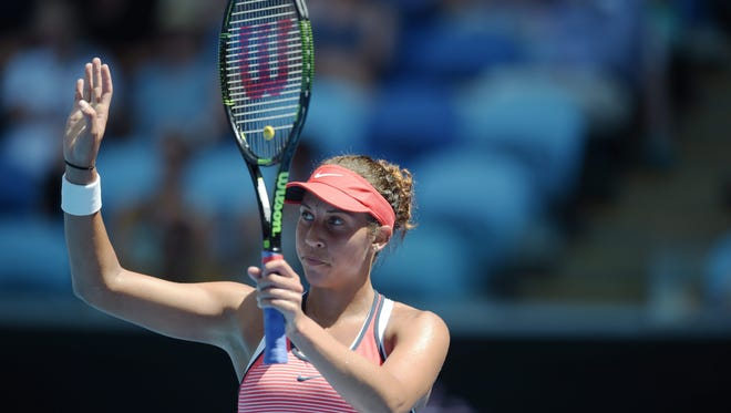 Madison Keys gestures as she plays against Zarina Diyas during their first round match during the Australian Open in Melbourne, Australia, Jan. 19, 2016.