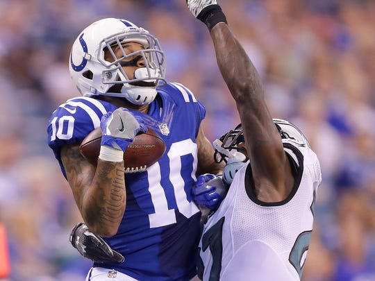Indianapolis Colts wide receiver Donte Moncrief (10) pulls down a reception as he's defended by Philadelphia Eagles free safety Malcolm Jenkins (27) during the first half of an NFL football game Saturday, Aug. 27, 2015, at Lucas Oil Stadium.