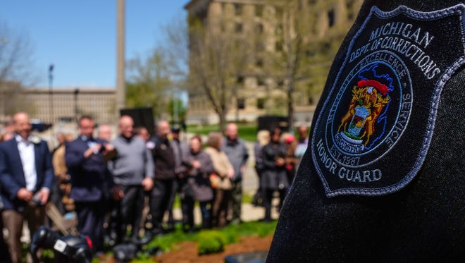 Nearly 200 people attend a memorial dedication ceremony for fallen corrections officers Sunday, May 7, 2017.